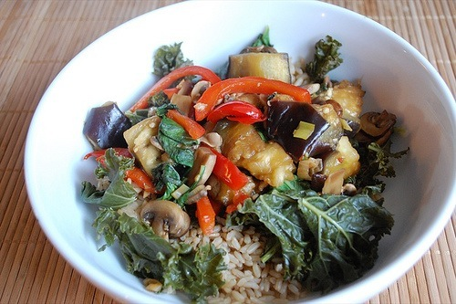 mixed vegetable stir-fry in a bowl over rice