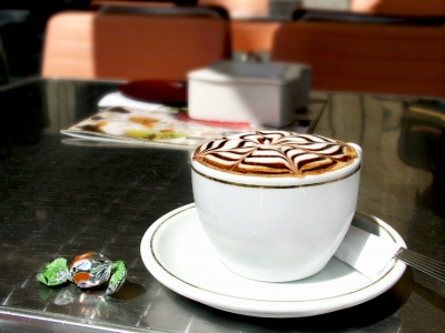 photo of cappuccino on a table in a coffee shop