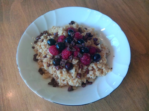 Chocolate chips and raspberries on top of oatmeal