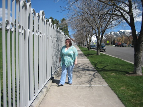 woman weighing about 300 pounds walking down a sidewalk