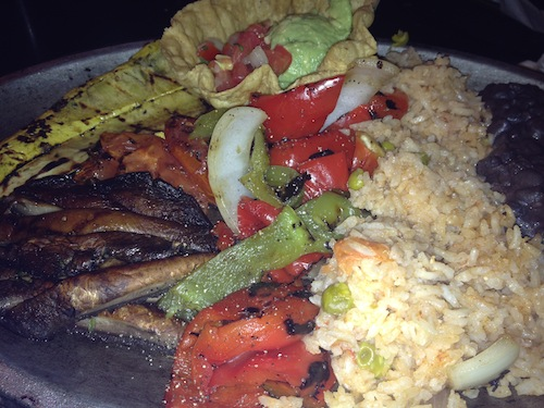 plate of black beans, rice and grilled vegetables for fajitas