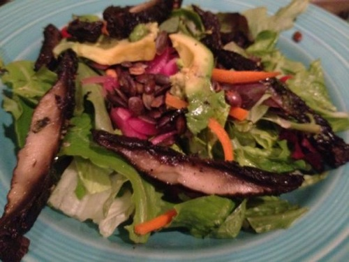 picture of a salad with pickled onions and sliced portobello mushrooms