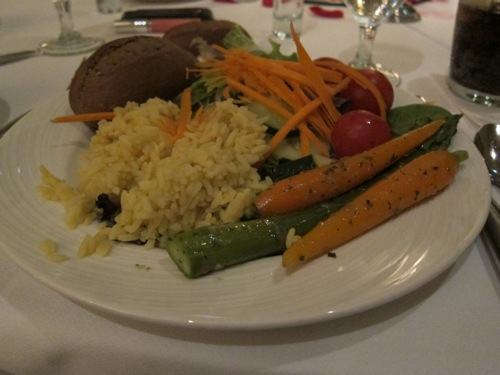 plate of grilled vegetables, rice and bread