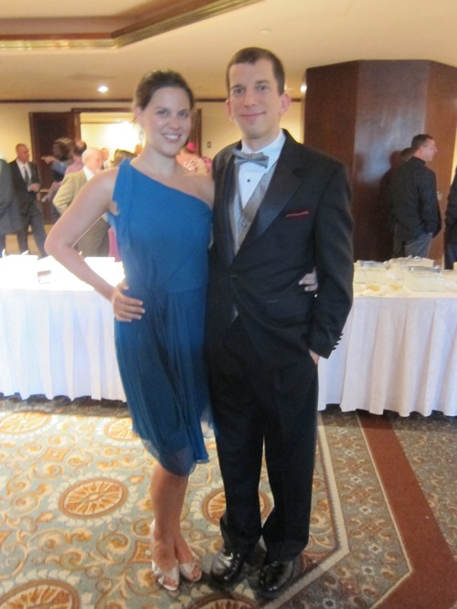 Lindsay in a blue dress and Jim in a suit with a silver vest that matches her shoes