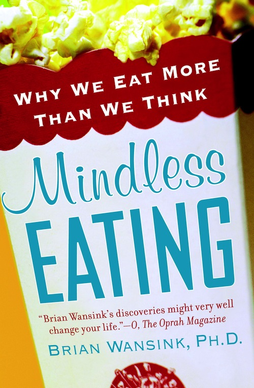 image of the book cover of Mindless Eating. It is a bag of overflowing popcorn