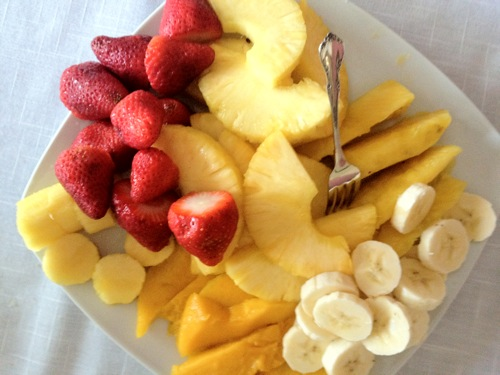 plate of pineapple and strawberries
