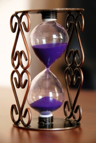 hourglass filled with purple sand