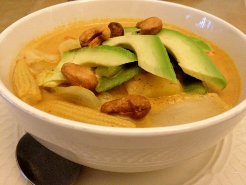 Massaman Curry, topped with potatoes, avocado and cashews