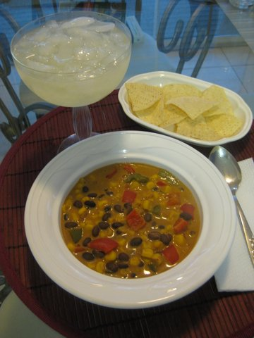 Mexican Chowder in a bowl with a margarita and chips on the side