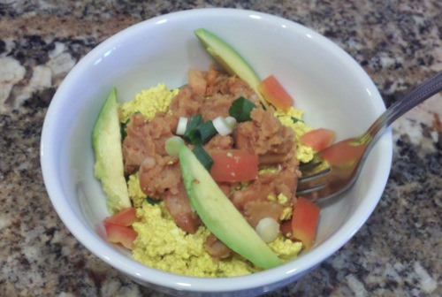 vegan tofu scramble with refried beans, avocado and tomatoes