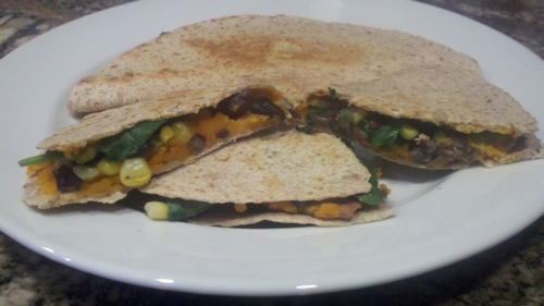 vegan sweet potato quesadillas on a white plate